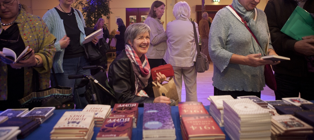 Audience member buying books at Festival event