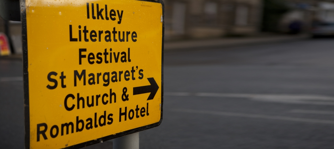Yellow AA road sign showing way to Festival venue