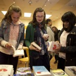Young people browsing books at Ilkley Playhouse
