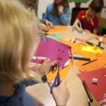 Children cutting paper to make pop up books