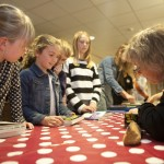 Writer Angie Sage signing books for children