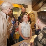 Young girl meeting illustrator David Roberts