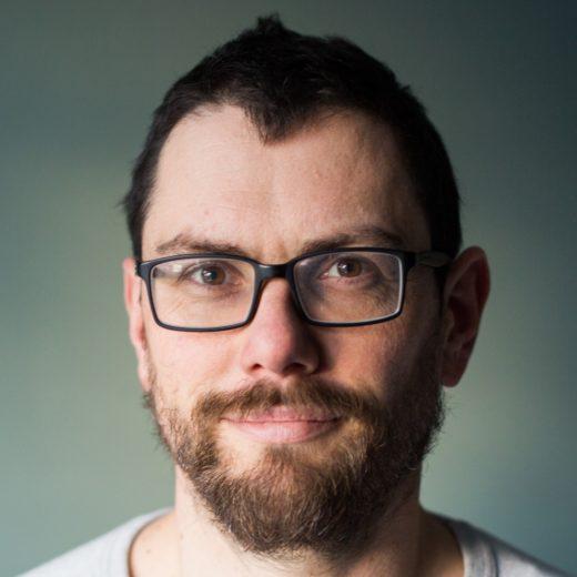 Image of man wearing glasses smiling